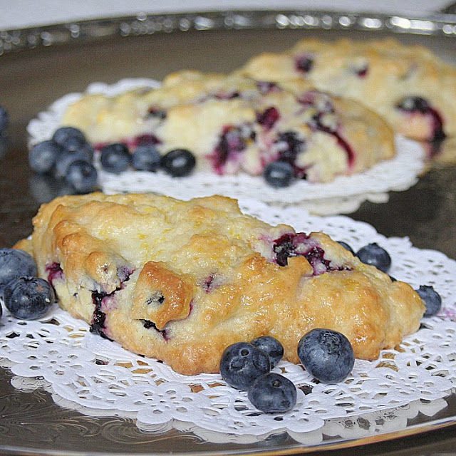 Sharing another blueberry treat ~ scones. These are wonderful blueberry scones from Tyler Florence and have a wonderful lemon glaze.