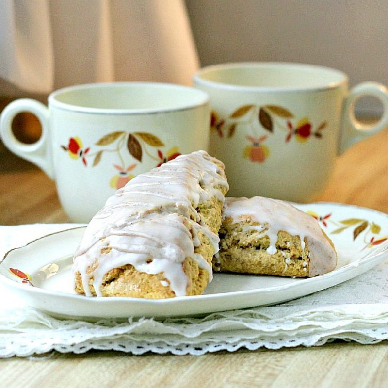 Easy recipe for spice glazed pumpkin scones with cinnamon, nutmeg, cloves and ginger. Delicious autumn breakfast or snack treat.