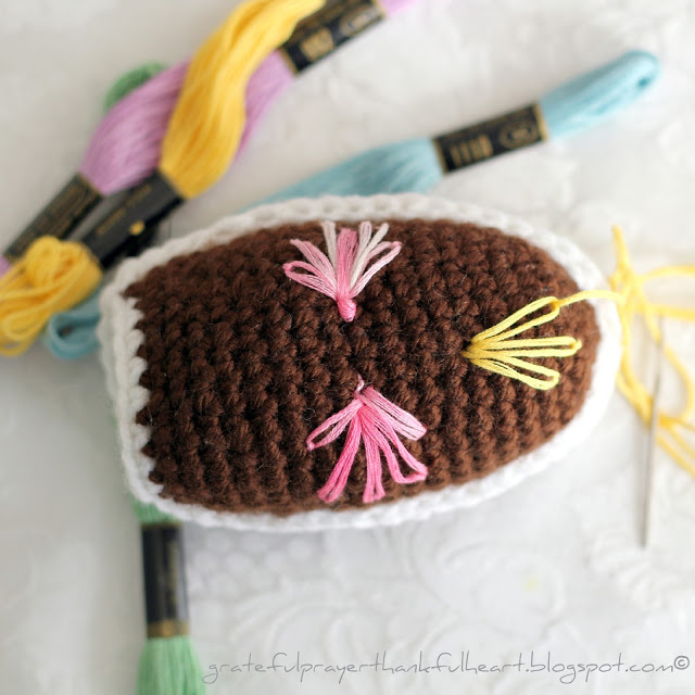 Pattern for Crochet Chocolate Diorama Easter Egg is a cute, chocolate-like egg with a little opening and faux frosting mimicking eggs that filled my Easter basket.