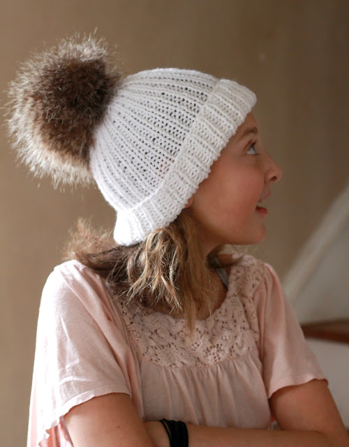 Make your own faux fur pom poms for hats and crafts easily and inexpensively. Check out this tutorial, How-to Faux Fur Pom Pom on Knitted Toque with link to easy knitted hat pattern.