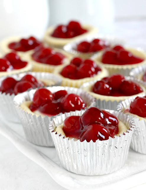 Looking for a delicious and easy to make dessert? Try Cherry Cheese Cupcakes. They are always a favorite and look so pretty. Perfect for bridal or baby showers, parties and holidays like Valentine's Day. Top with pie filling of choice. Easy to serve with no slicing too.