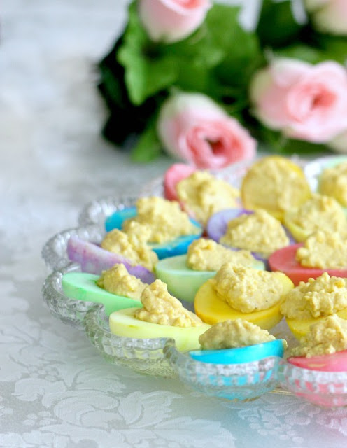 Classic Deviled eggs recipe in dyed egg whites for lovely pastel shades that look beautiful for Easter dinner.