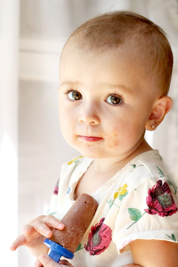 Joelle with frozen chocolate peanut butter pudding pop