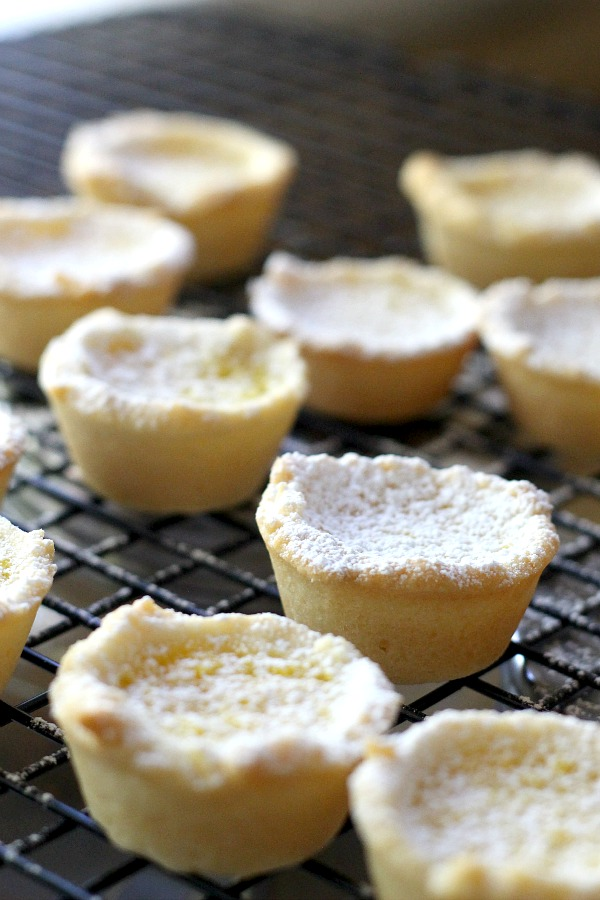 Lemon tartlets are tender little pie-like tartlets for every lemon lover! Easy how-to recipe for lemon tartlets with just the right amount of sweet and tart.
