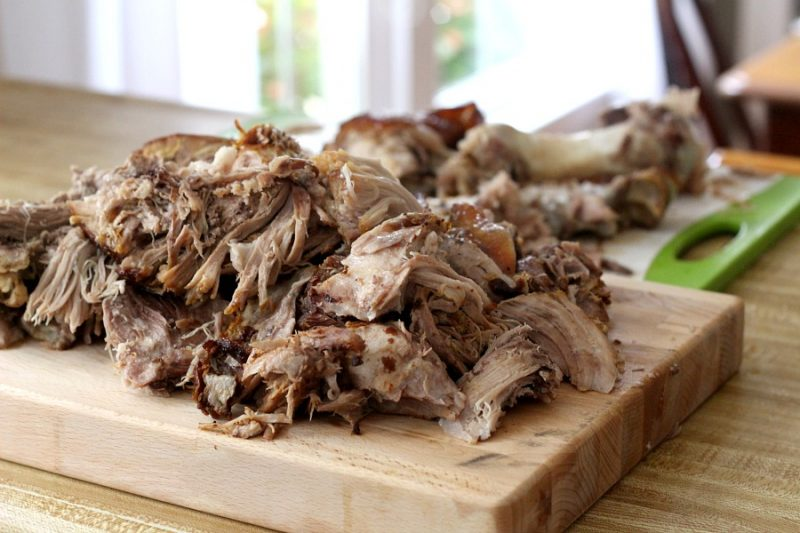 Roast an inexpensive pork shoulder in the oven slow and long for incredibly tender, delicious pulled pork. Pile on a roll with your favorite barbecue sauce. Amazing!