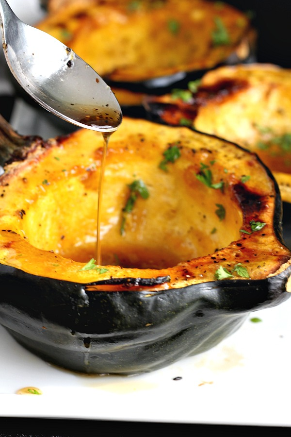 Baked acorn squash couldn't be easier. Bake the sliced and seeded squash with butter and maple syrup until fork tender. A lovely autumn side dish.