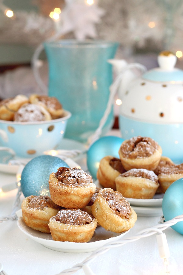 These sweet little tartlets called Pecan Tassies are like having a scrumptious bite-sized pecan pie. Sweet filling in a cream cheese pastry cup, they are also known as Nut Lassies.
