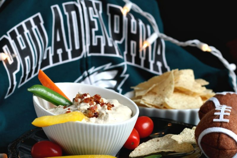 This retro, crowd-pleasing zesty dip never goes out of style. Onion Soup Horseradish and Bacon Dip is thick, creamy and stands up to fresh veggies, crackers and hearty chips. Serving for Super Bowl Sunday and cheering on the Philadelphia Eagles. Fly, Eagles, Fly!