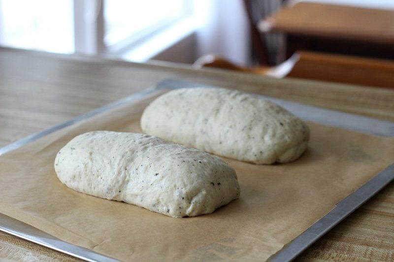 Cracked Pepper, Parmesan and Herbed Bread is full of flavor, slices beautifully and great for sandwiches or buttered and served with soup or salad. Easy recipe dough is made in a bread maker and shaped as desired. Allow to rise, bake and enjoy!