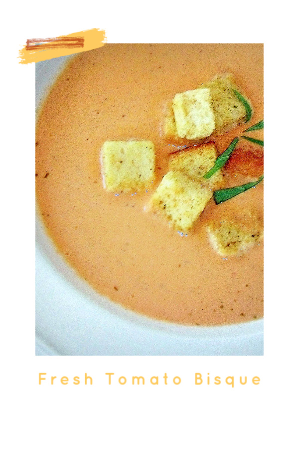 A delicious and easy recipe for fresh tomato bisque. Rome tomatoes and basil with cream and croutons make for a bright and tasty soup.