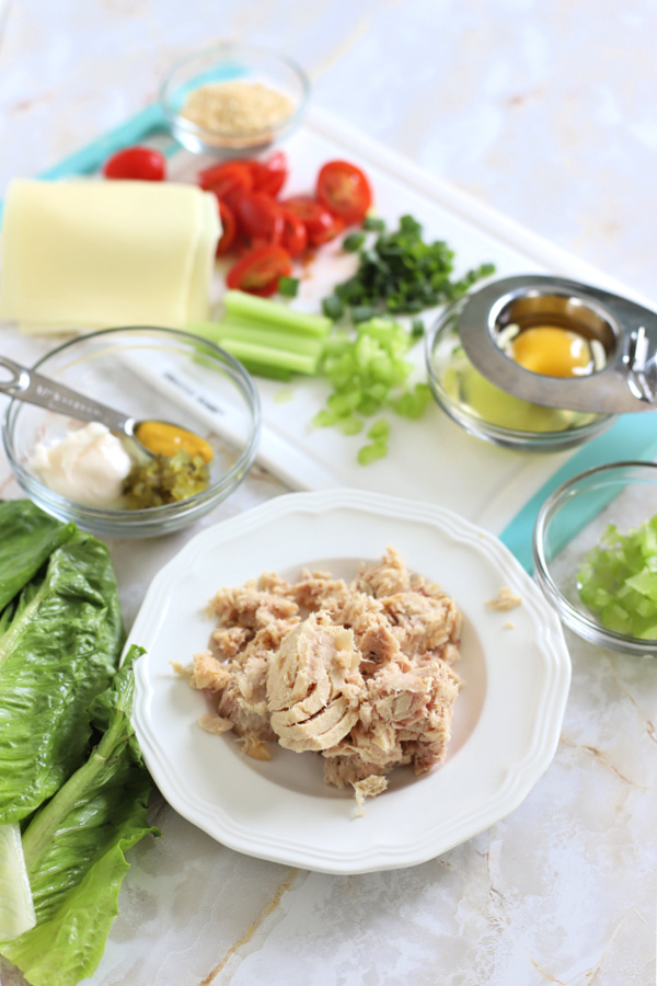 Ingredients for making a classic grilled tuna melt on a bun or English muffin.
