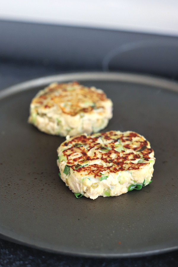 Grilling tuna melt patties for a classic tuna melt sandwich on a bun or English muffin.
