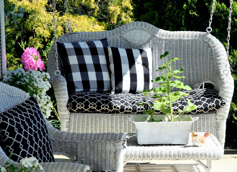 Sprucing up and decorating with accessories, flowers and garden plants getting ready for leisurely  spring and summertime front porch living.