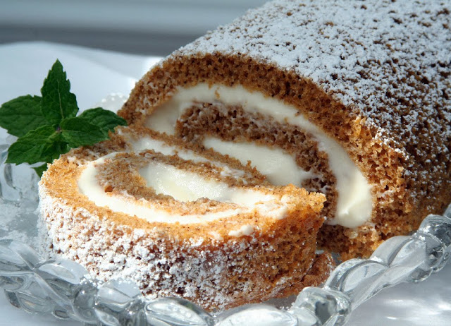 Cream cheese filled pumpkin roll for Thanksgiving dessert.