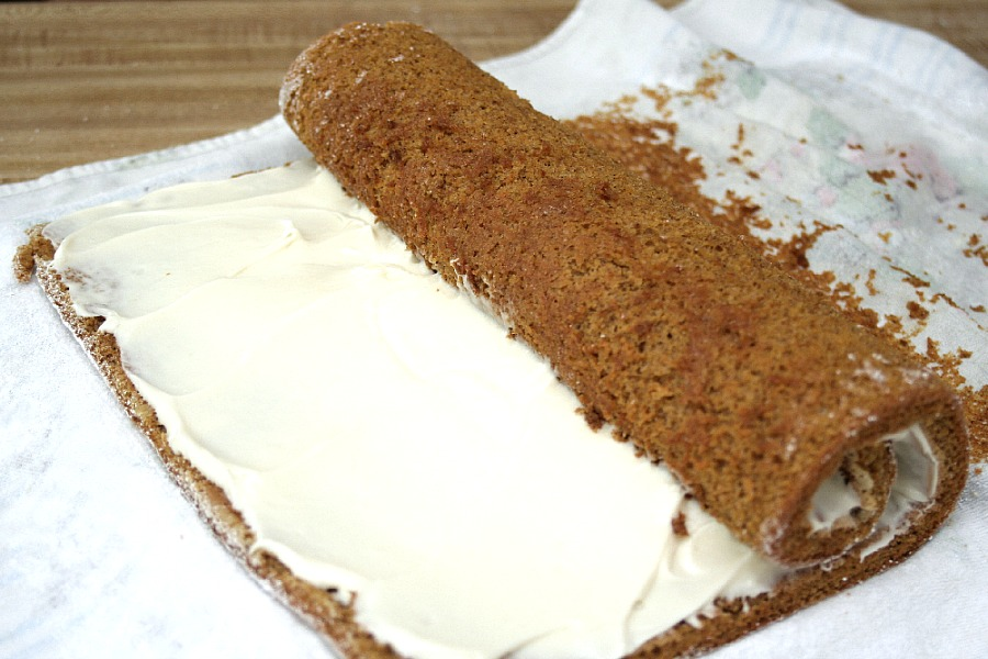 Famous and ever popular Pumpkin Roll. Sweet pumpkin cake with a rich cream cheese filling is a traditional Thanksgiving favorite on the dessert table.