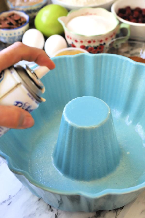 Preparing pan for all the flavors Thanksgiving Bundt cake