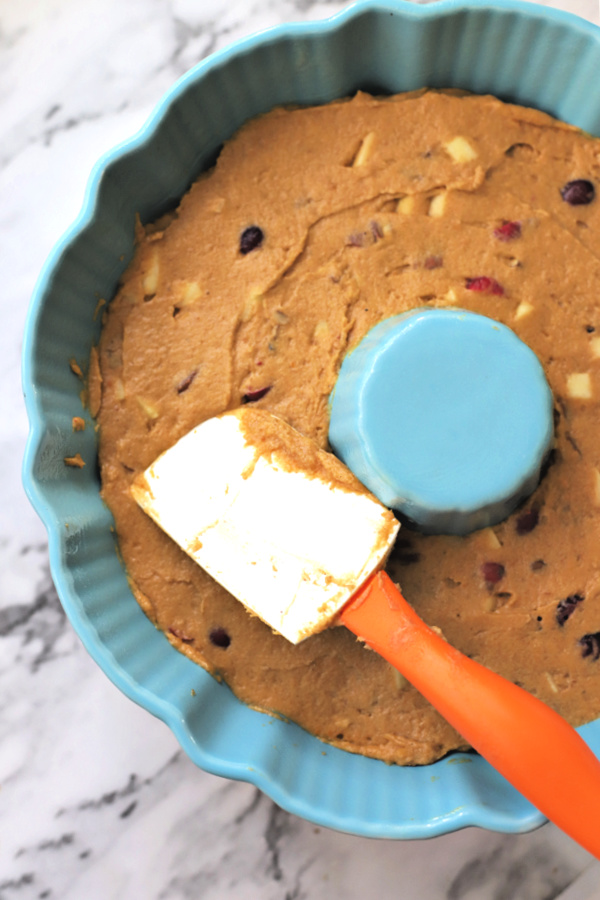 Spreading all the flavors of Thanksgiving cake batter in Bundt pan.