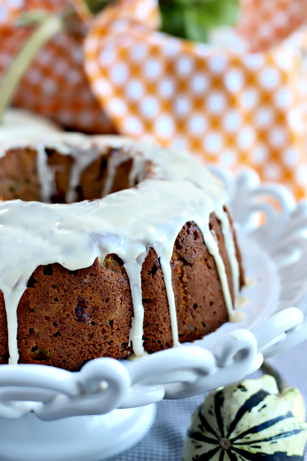Maple syrup glazed Thanksgiving Bundt cake with all the seasons favorite flavors.