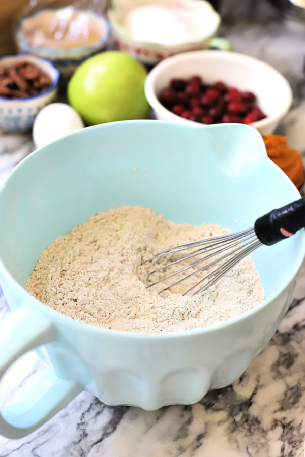 Whisking dry ingredients for all the flavors Thanksgiving Bundt cake