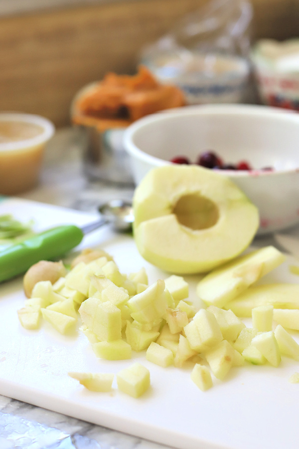 Chopping apples for all the flavors Thanksgiving Bundt cake