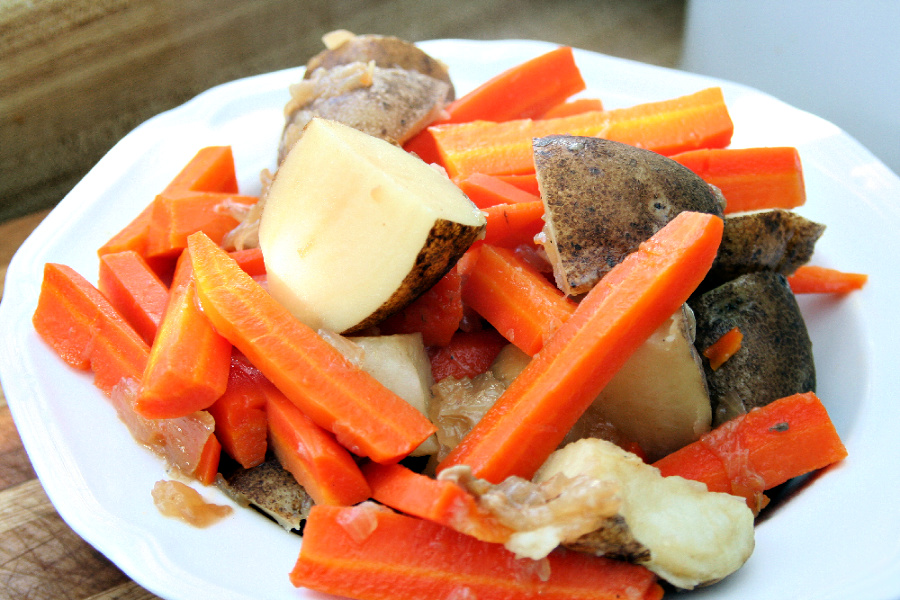 Easy, step-by-step recipe for old fashioned beef rump roast. Simmered slowly on the stovetop with carrots and potatoes until tender, it is a perfect family Sunday dinner.