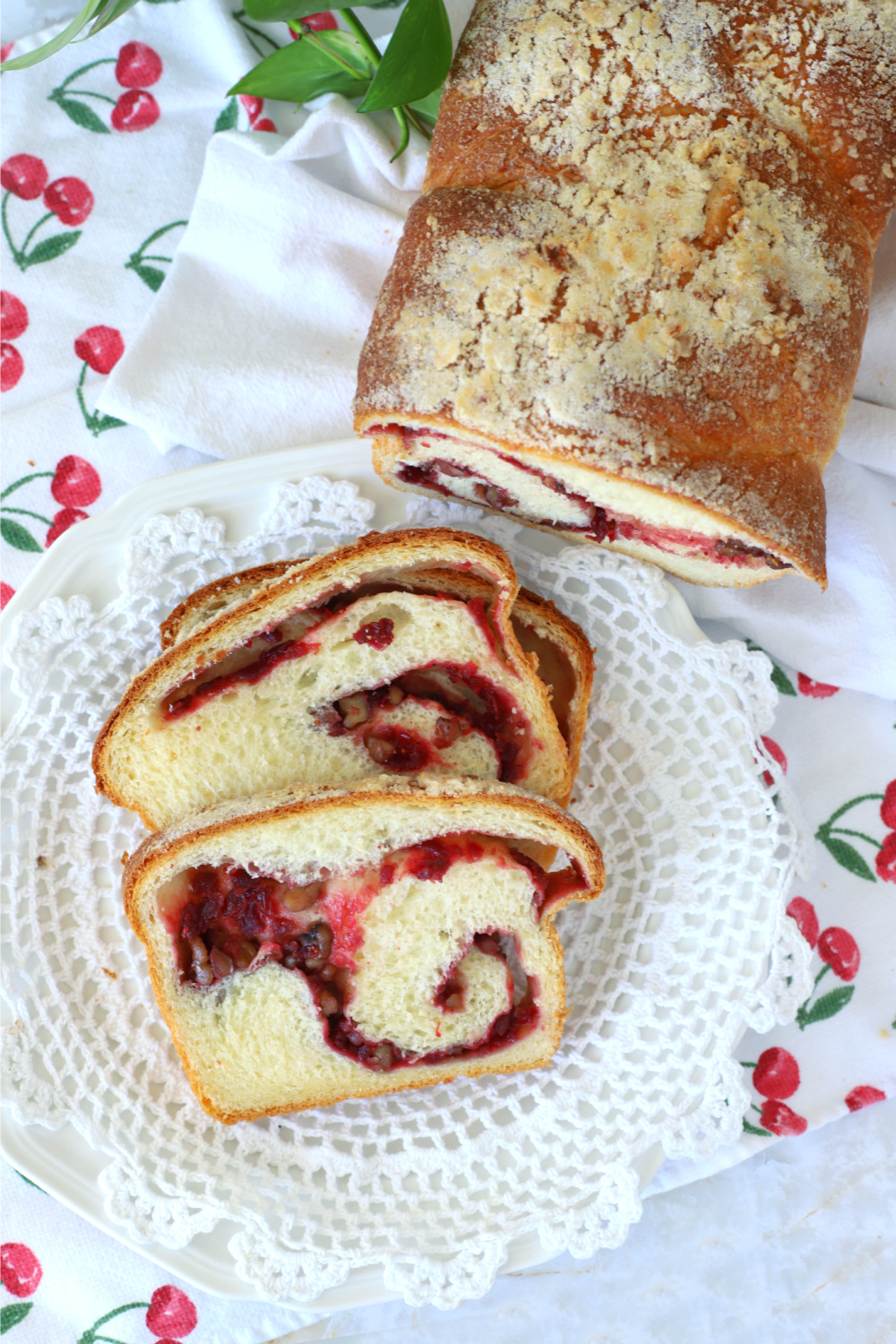 Easy recipe for a loaf of cranberry swirl bread with a pretty filling using fresh or frozen cranberries and walnuts or pecans. Yeast dough made with a bread machine or by hand.