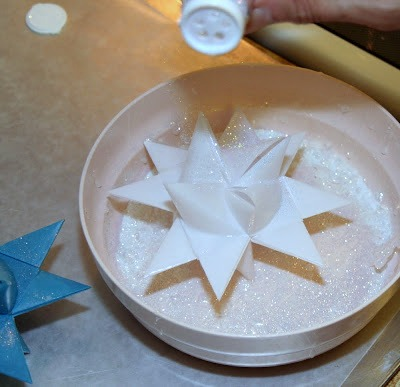 Tutorial for dipping folded paper German Stars in wax to preserve and protect from outdoor elements.