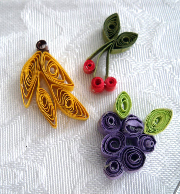 Paper quilling is a craft using thin strips of paper. Create flowers, tendrils and sweet little hearts to decorate and embellish all kinds of projects like this heart pendant.