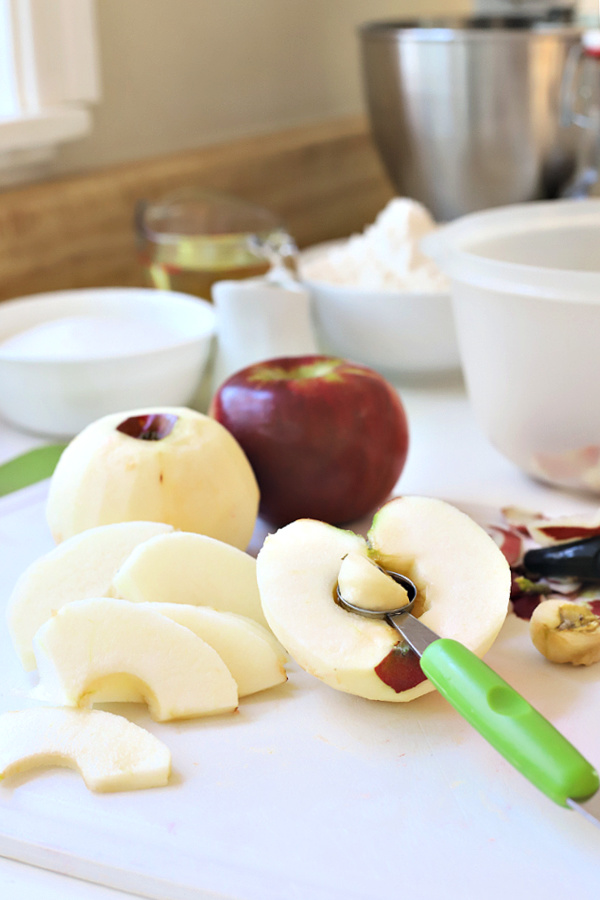Peeling, coring and slicing apples for a Jewish apple cake