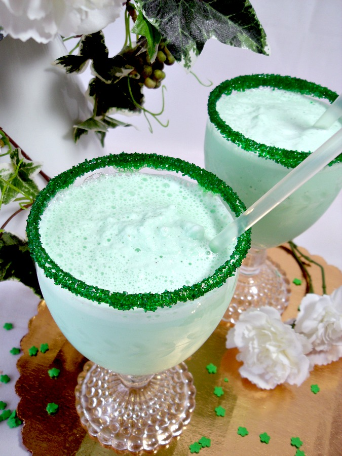 Frosty and minty, Shamrock Milkshake is similar to its fast-food version available each March for St Patrick's Day. Easy recipe to make you own using ice cream, milk, cream and mint for a delightful beverage treat.