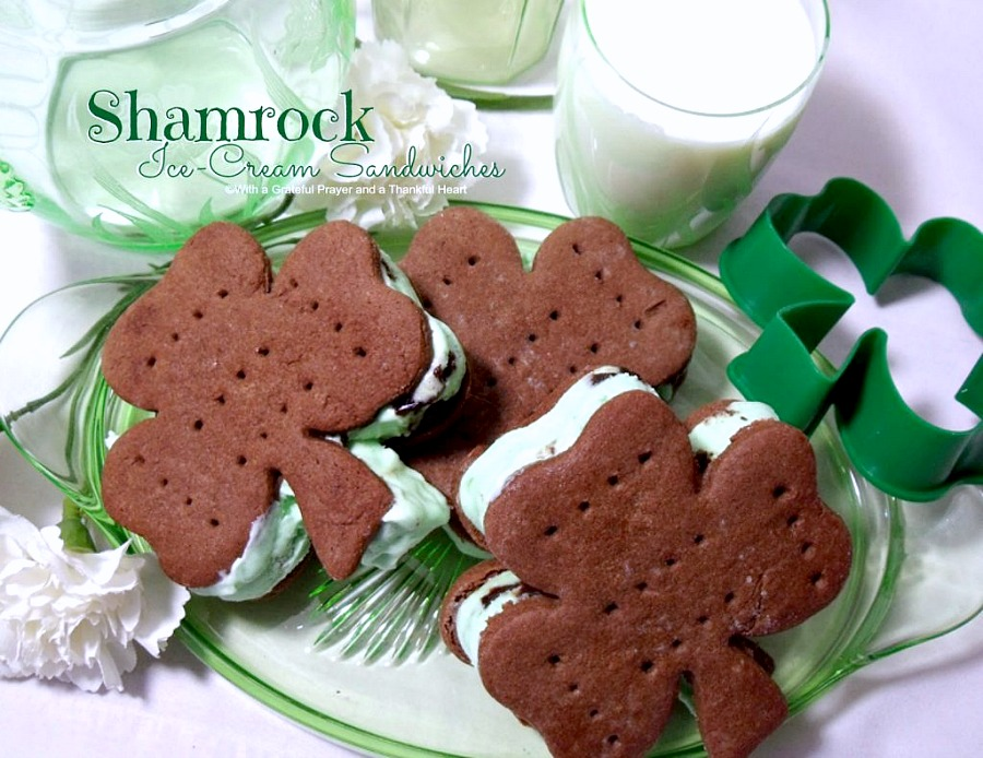 Easy recipe for homemade chocolate cookies cut into shamrock shapes with a cookie cutter. Spread with mint chocolate chip ice cream to create festive St Patrick's Day Minty Ice Cream Shamrocks treats.
