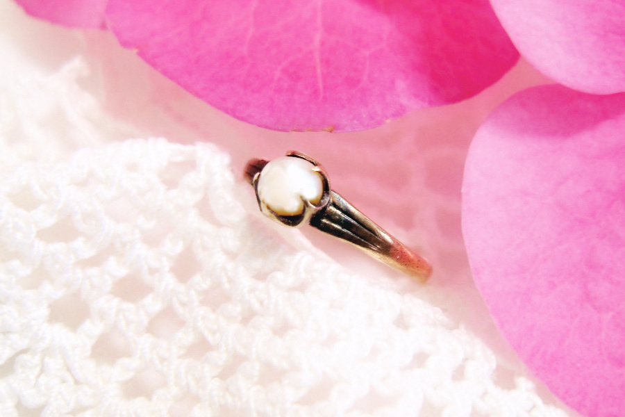 Tiny and sweet, mid-century pearl baby ring is a vintage keepsake. A sentimental gift from a beloved aunt and now worn on a chain as a necklace pendant.
