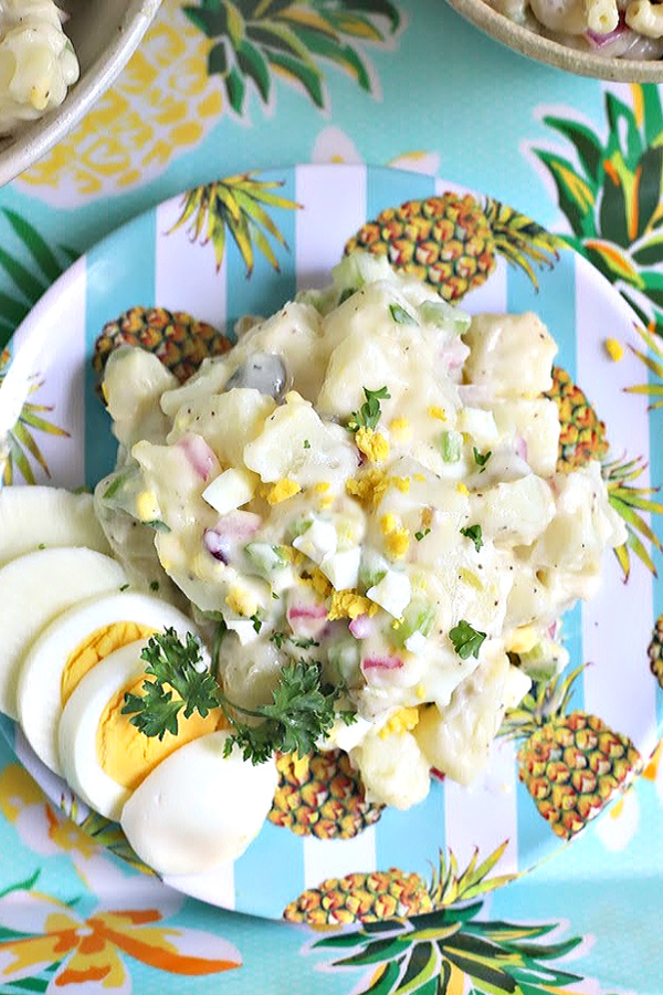 Easy recipe for traditional potato salad that is full of flavor from sweet gherkin pickles, celery, onions & eggs. It's a classic 4th of July cookout favorite side dish with burgers, BBQ chicken and hotdogs! Yummy with baked beans too.