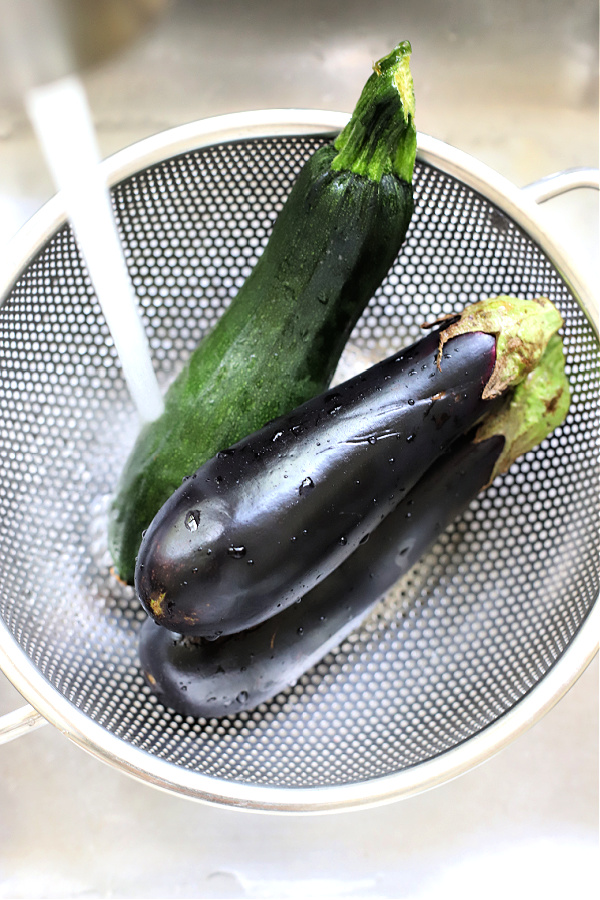 rinsing fresh eggplant and zucchini for grilling