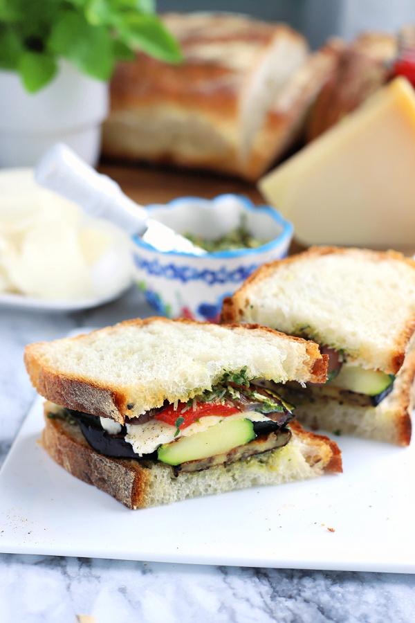 making a grilled eggplant zucchini vegetable panini sandwich