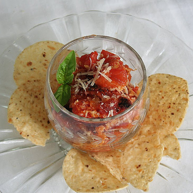 Old- fashioned Scalloped Tomatoes are a perfect, garden fresh, appetizer or side dish made with plum tomatoes, basil, garlic and French bread cubes.