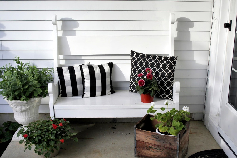 Handmade wooden bench from a vintage Southern Living pattern has found a home in the kitchen, on the front porch and on the patio.