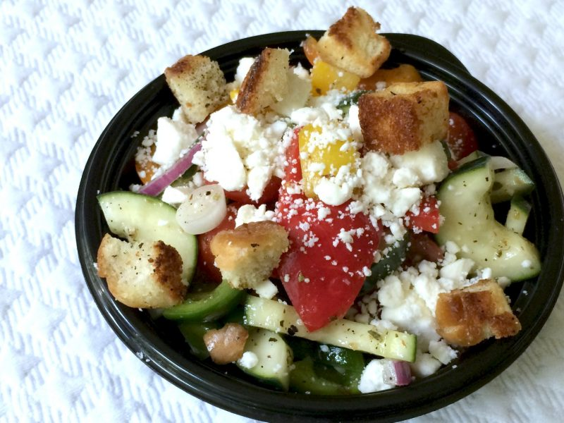 Colorful Greek panzanella salad combines the seasons freshest ingredients with a vibrant and delicious vinaigrette and topped with feta and crispy croutons.