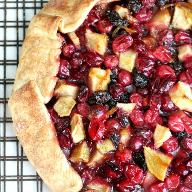 Easier that making a pie, Cranberry Lime Galette is both beautiful & delicious. Folded crust is filled with fresh and dried cranberries, apples and raisins.