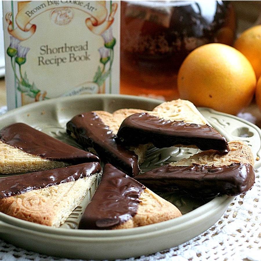 Easy recipe for chocolate dipped, orange spice shortbread. Delicious and beautiful with or without sprinkled nuts to enjoy with coffee or tea. Lovely addition to the holiday cookie tray and wonderful as homemade gift from the kitchen.
