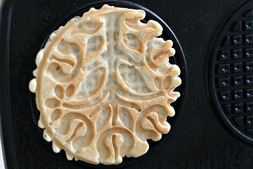 Easy recipe for crisp Italian pizzelles with anise seed made with a pizzelle maker. Perfect for your Christmas cookie tray or dessert table.