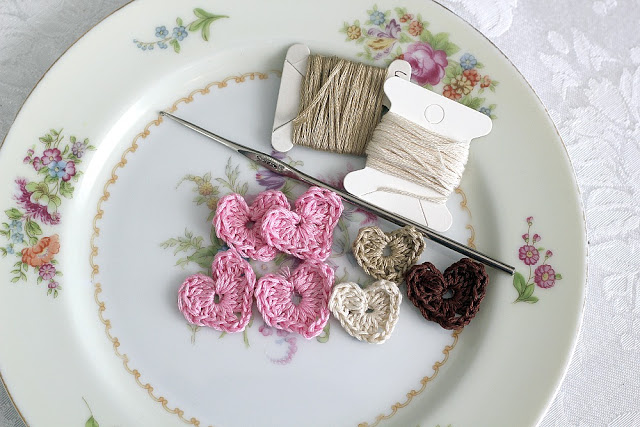 Quick and easy, tiny crocheted hearts can be used to embellish crafts and greeting cards for Valentine's Day, Mother's Day and Birthday gifts