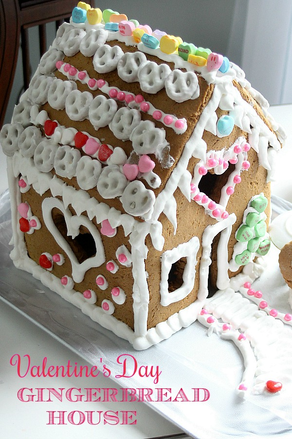 Super sweet Valentine's Day Gingerbread House is magical. Decorate with Royal Icing as the glue for favorite candy and treats. Great kids project.