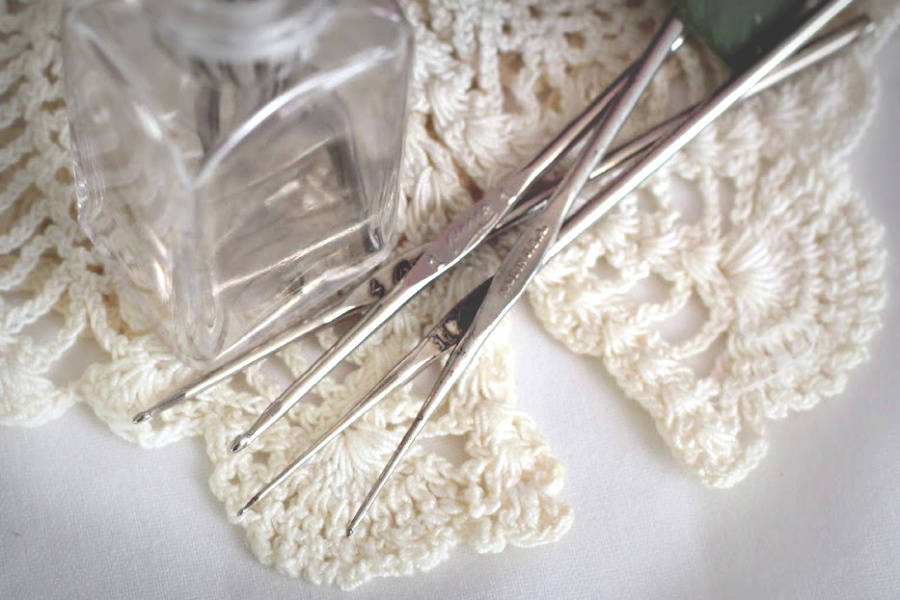 Tiny vintage crochet hooks grandmother used to make doilies, hankies, bonnets and sweaters.