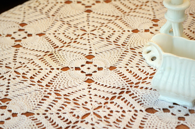 A lovely example of grandmother's workmanship and handiwork is her vintage tablecloth. Crocheted in the pineapple pattern and made in the 1940's using tiny crochet hooks.