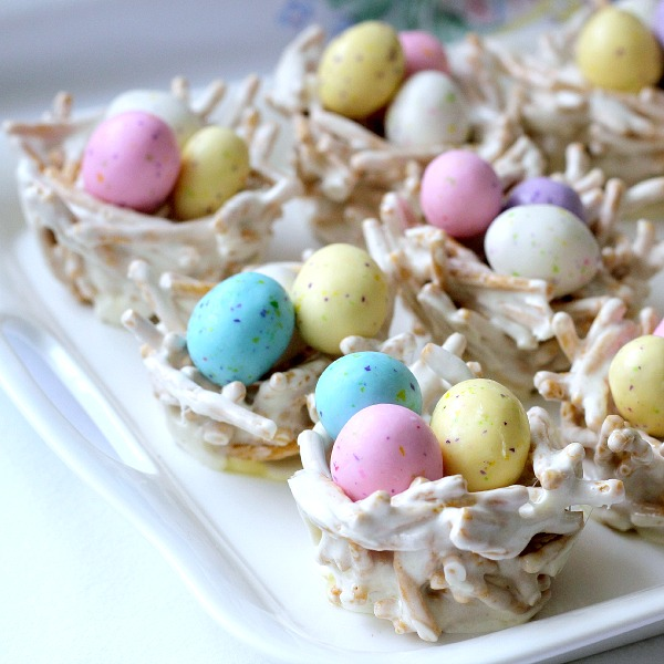 Cute, edible Easter springtime bird nests are adorable for Easter. Pretty pastel candy eggs nestled in twig-like bundles make a lovely welcome to dinner guests. They are made using Chow Mein noodles giving the appearance of sticks gathered by the birds to construct their nests.