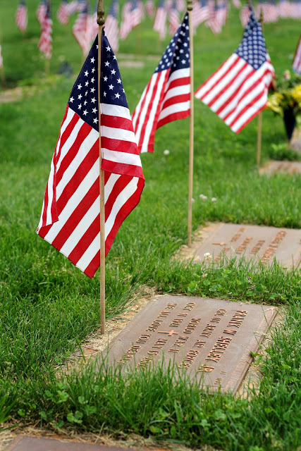 Remembering Memorial day and those who served including World War 1 and World War 2 with American flags decorating each grave at Brigadier General William C. Doyle Veterans Memorial Cemetery.