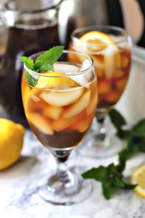 Easy how-to recipe for making brewed iced tea. Steep tea bags, add sugar or leave unsweetened, add a squeeze of fresh lemon or orange juice and a sprig of mint. Serve chilled over ice for a refreshing beverage.