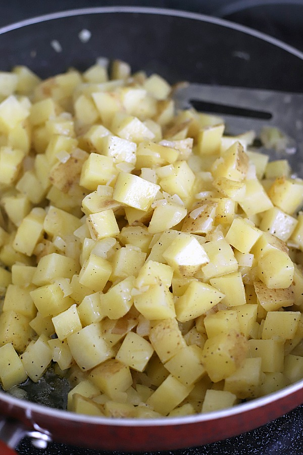 Easy recipe for homemade hashed browns. Diced potatoes are cooked in butter to perfection with a crispy exterior and great potato flavor. Great with eggs and bacon for breakfast or as a dinner side dish.