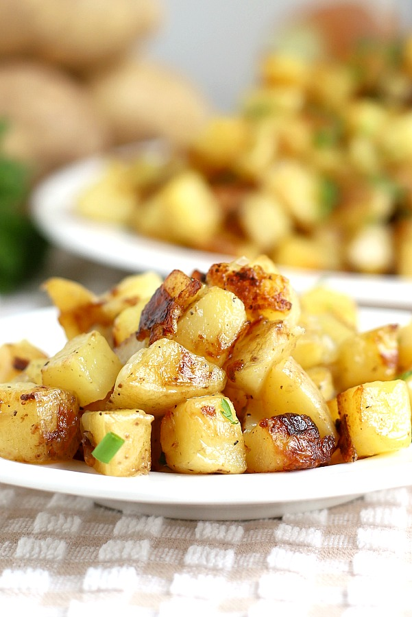 An easy recipe for homemade hashed browns from buttery potato cubes cooked until the exterior is crispy and the center is tender. So right with breakfast eggs and bacon or as a dinner side.
